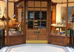 Shop entrance, mosaic tiles with step tread tiles. Hand made logo for David Mellor, kitchen supplies shop in Marylebone.